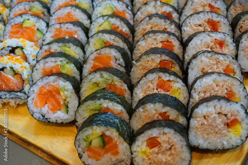 Delicious Various Types Of Sushi Rolls Slices In Bunch