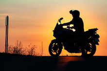Man On His Motorbike Riding Into Sunset