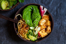 Vegan Bowl With Avocado, Silky Tofu, Bean Sprouts And Pickled Vegetables Over Rice