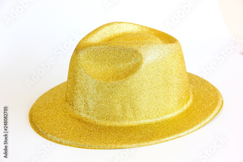 Obraz na plátne  plastic fancy hat decorated in gold on white background