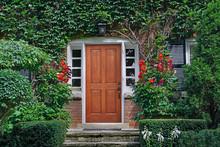 Elegant Wooden Front Door Of Vine Covered House