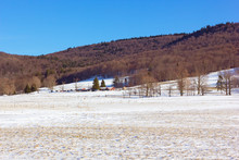 A Field For Cross-country Skiing Trail In West Virginia, USA. The Field Covered In Snow And Surrounded By Mountains.