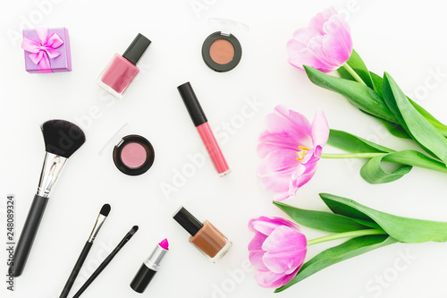 canvas print motiv - artifirsov : Beauty composition with pink tulips bouquet and cosmetics on white background. Top view. Flat lay.