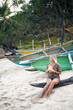 Blond Woman Drink Coconut Water on Wooden Boat