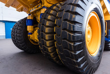 Huge Wheels Of A Yellow Dump T...
