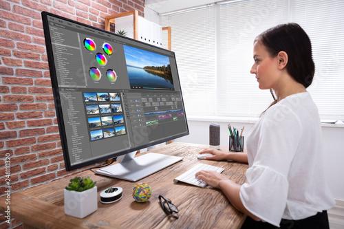 Staande foto Hoogte schaal Female Editor Editing Video On Computer