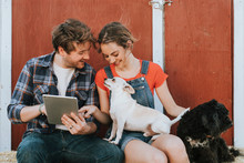 Happy Couple Living With Their Rescued Dogs