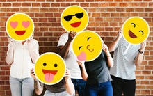 People Holding Positive Emoticons