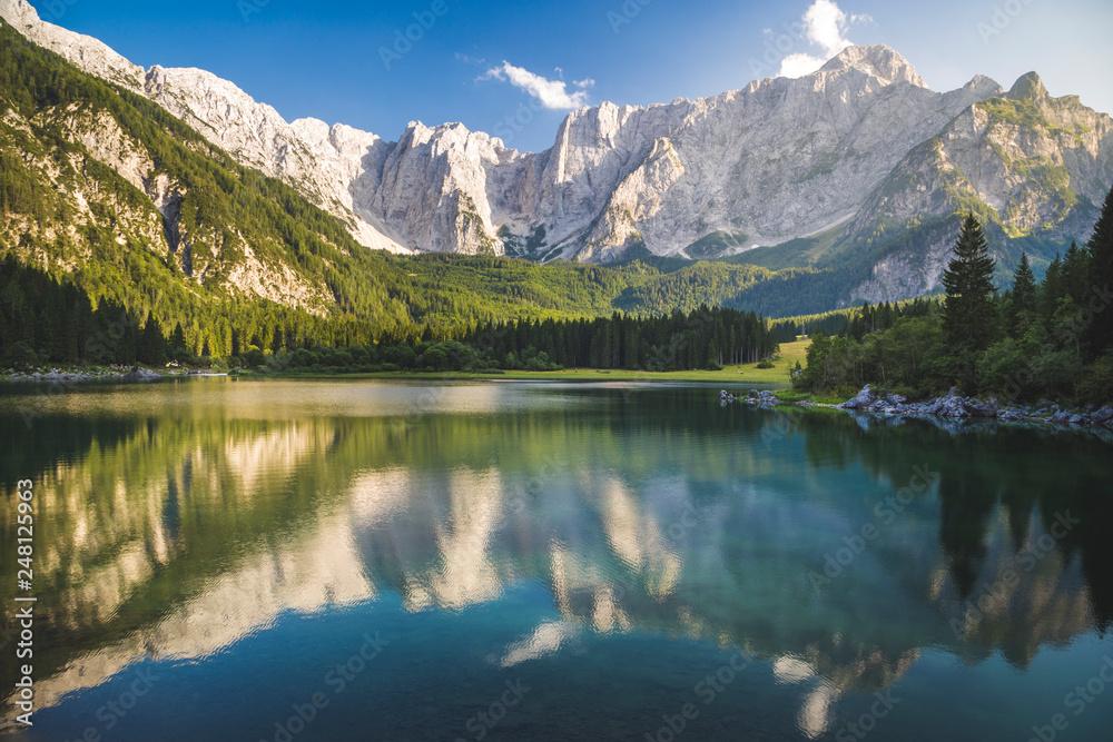 Fototapeta Superior Fusine Lake with Mount Mangart on the background. Fusine Lakes Natural Park, Tarvisio, Udine province, Friuli Venezia Giulia, Italy.