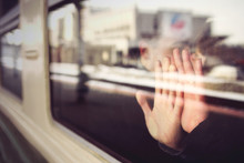 Two Hands, Male And Female On The Train Window. The Couple Is Sitting On The Train, Touching The Glass With Their Hands. Love And Romance In Travel. Selective Sharpness