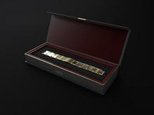 3d Illustration Of Open Square Black Gift Box With Bracelet On Black Background.