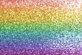 Fototapeta Tęcza - Composition of sparkling rainbow glitter as background