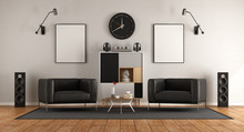 Living Room With Two Black Arm...