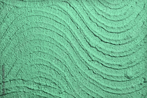 Fotografiet  teal, sea-green scratched curve stucco on wall texture - nice abstract photo bac