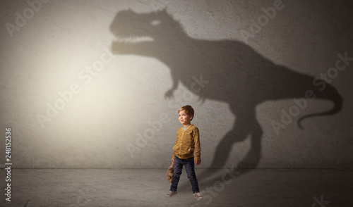 I m dreaming about dinosaurus concept with cute little boy in an empty room Wallpaper Mural