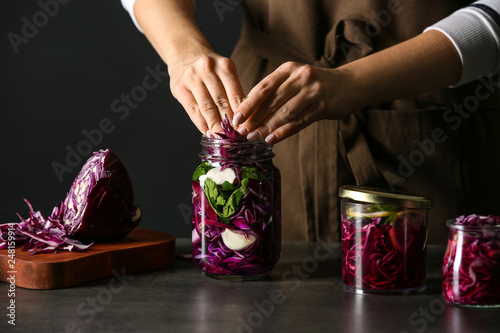 Woman preparing fresh cabbage for fermentation on table Fototapete