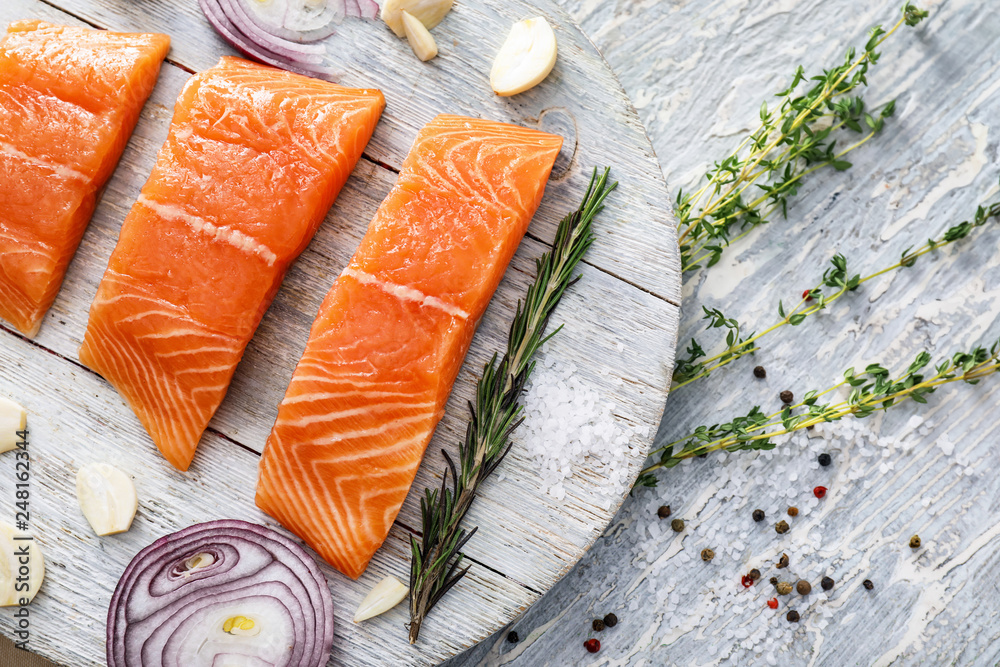 Fototapety, obrazy: Raw salmon fillet on wooden board