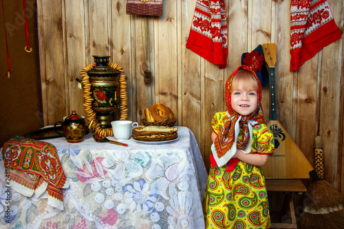 Fotografie, Obraz  a little girl in russian folk clothes at the celebration of the slavic holiday o