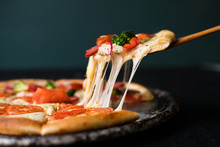 Tasty Sliced Pizza With Basil ...