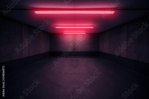 Fotografija dark underground room with red neon light in basement or parking lot -