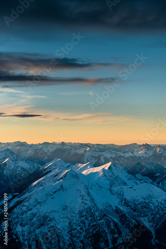 Poster Corail Scenic mountain landscape of snowy Zugspitze mountains in Bavarian Alps, Germany. Sunset