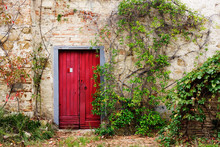 Red Door In Old Brick And Ston...