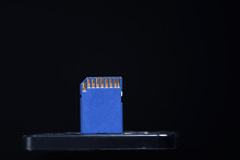 Blue SD Flash Card On Black Background.
