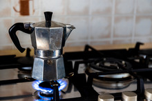 Espresso Coffee In The Old Moka Coffee Pot. Preparation Of Traditional Italian Coffee, In Mocha On The Stove.