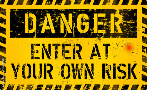 Photo Danger, Enter of your own risk, risk warning or computer virus sign, worn and gr