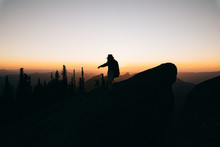 Silhouette Of Person Walking On Mountain During Sunset