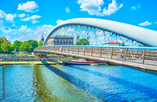 Fototapeta The modern footbridge across Vistula River in Krakow, Poland obraz