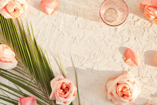 Summer Cosmetics Pastel Pink Flat Lay With Shadows. Top View Of Beauty Flower And Tropical Composition