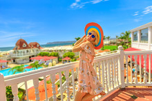 Happy Lifestyle Tourist Woman Enjoying At A Balcony Of Beachfront Luxury Hotel At In Coronado Island, San Diego. Summer Holidays In California. Aerial View Of Pacific West Coast In USA. Sunny Blue Sky