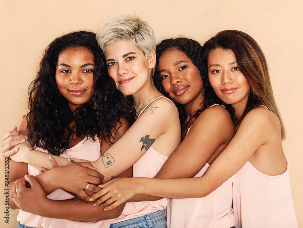 Fototapety, obrazy: Studio shot of a group of beautiful young women hugging each other