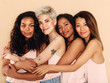canvas print picture - Studio shot of a group of beautiful young women hugging each other
