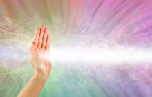 Pranic Healer Using Right Hand To Beam Healing Energy -  Female Hand Facing Out With A Beam Of White Energy Streaming Out Against A Rainbow Coloured Energy Field Background With Copy Space