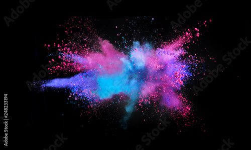 Multi colored powder explosion isolated on black - 248233194