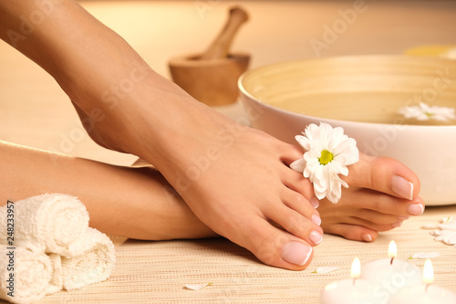 Foto auf Gartenposter Pediküre The picture of ideal done manicure and pedicure. Female hands and legs in the spa spot.