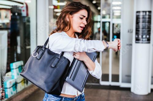 Fototapeta Business woman goes in a hurry to work obraz