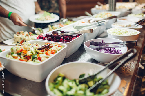 Assortment of fresh dishes displayed in hotel buffet Wallpaper Mural