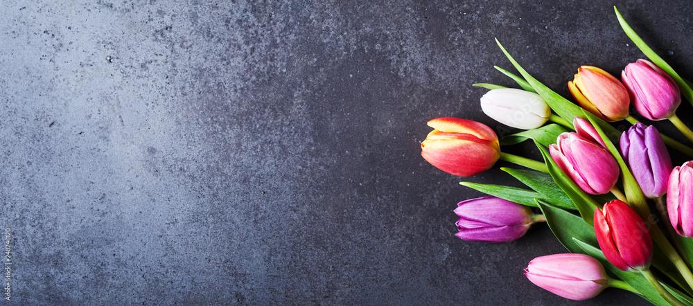 Fotografie, Obraz Tulips bouquet on dark grey background