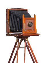 Antique Camera On Old Tripod Isolated On White