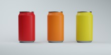 Three Colors Soda Cans On Elegant White Background