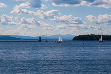 Sailboats On Lake Champlain, Vermont With Adirondack Mountains In The Background