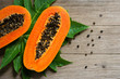 canvas print picture - Papaya fruit on wooden background.Slices of sweet papaya on wooden background,Halved papayas