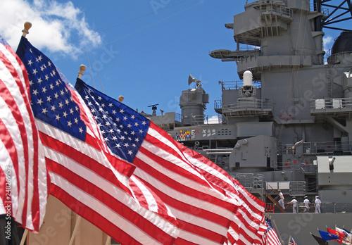 US flags flying beside the Battleship Missouri in Pearl Harbor, Honolulu, Oahu, Hawaii with 4 sailors walking on deck Canvas Print