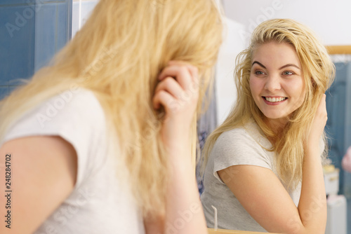Happy fresh blonde woman in bathroom