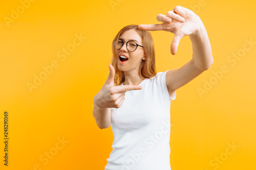 Beautiful Young Girl With Glasses Making A Camera Frame With