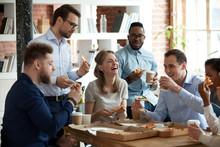 Happy Diverse Team People Talking Laughing Eating Pizza In Office