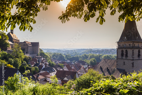 Foto  Morning haze over historic city Warburg, Germany